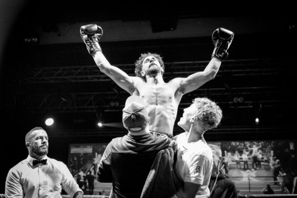 Boxer raised in celebration at winning